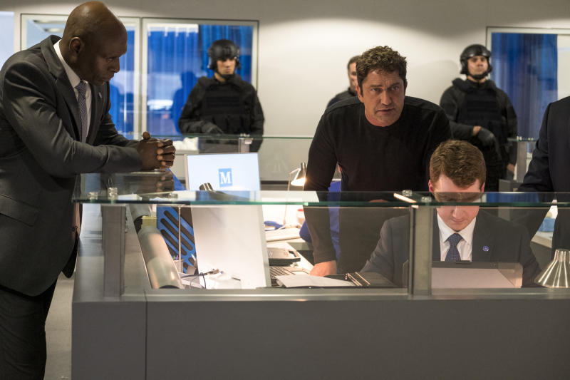 """This image released by Lionsgate shows Lance Reddick, left, and Gerard Butler in """"Angel Has Fallen,"""" directed by Ric Roman Waugh. Hollywood's summer season came to a close Sunday, Sept. 1, 2019, with a whimper, as Butler's action thriller topped the box office for the second weekend and ticket sales on the season finished 2% behind last year. The Labor Day weekend is traditionally a quiet one for movie theaters. No major releases entered the marketplace, allowing the third installment in the """"Fallen"""" series to stay on top with an estimated $11.6 million.  (Jack English/Lionsgate via AP)"""