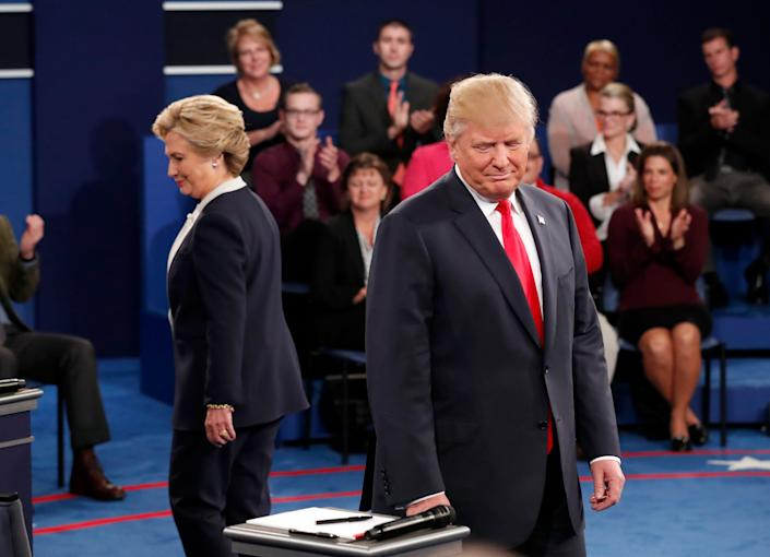 Hillary Clinton and Donald Trump before a presidential debate at Washington University in St. Louis, on October 9, 2016.
