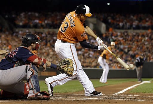 Baltimore Orioles' Manny Machado singles in the second inning of a baseball game against the Boston Red Sox in Baltimore, Saturday, Sept. 29, 2012. Chris Davis scored on the play. (AP Photo/Patrick Semansky)