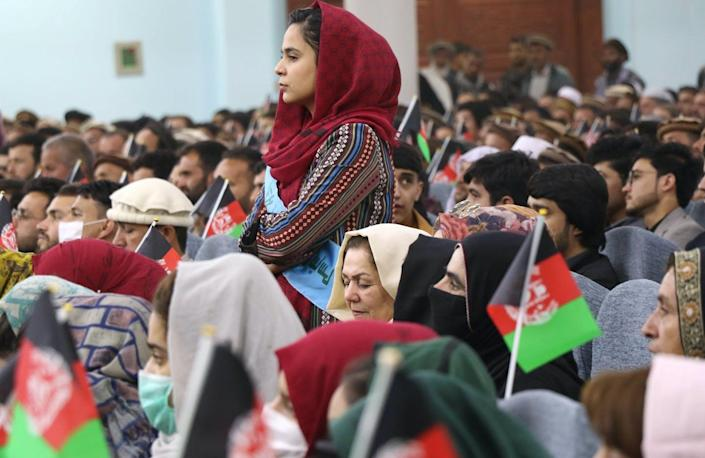 """<span class=""""caption"""">Afghan citizens at a March 2021 rally in Kabul to support peace talks between the Taliban and the government. </span> <span class=""""attribution""""><a class=""""link rapid-noclick-resp"""" href=""""https://www.gettyimages.com/detail/news-photo/afghan-women-youths-activists-and-elders-gather-at-a-rally-news-photo/1232002648"""" rel=""""nofollow noopener"""" target=""""_blank"""" data-ylk=""""slk:Haroon Sabawoon/Anadolu Agency via Getty Images"""">Haroon Sabawoon/Anadolu Agency via Getty Images</a></span>"""