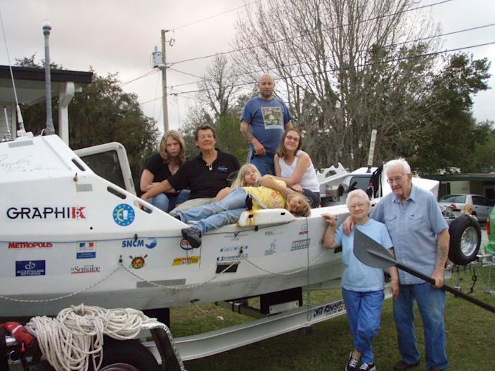 """Angela Madsen's boat surrounded by family members. <span class=""""copyright"""">(Courtesy of Deb Madsen)</span>"""