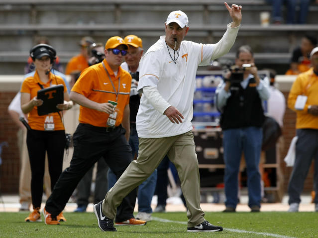 Tennessee head coach Jeremy Pruitt signals for the teams to head to the locker room after the Orange and White spring game at Neyland Stadium on Saturday, April 21, 2018 in Knoxville, Tenn. (C.B. Schmelter /Chattanooga Times Free Press via AP)