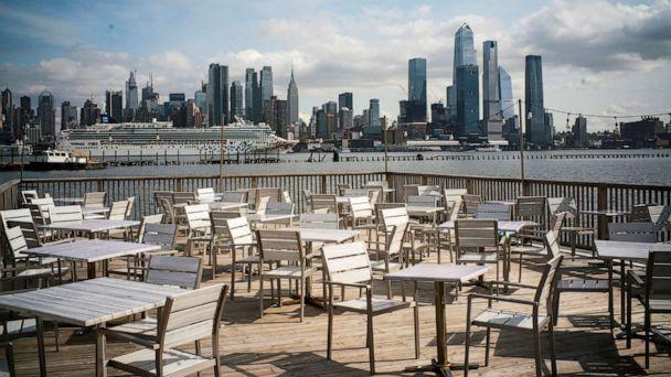 PHOTO: Empty chairs are seen at the deck of a local restaurant that is closed due to the outbreak of coronavirus disease (COVID-19), in Hoboken, N.J., March 16, 2020. (Eduardo Munoz/Reuters)