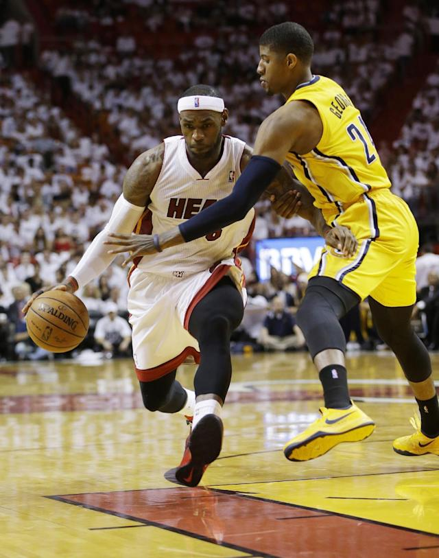 Indiana Pacers forward Paul George (24) defends Miami Heat forward LeBron James (6) during the second half of Game 3 in the NBA basketball Eastern Conference finals playoff series, Saturday, May 24, 2014, in Miami. (AP Photo/Lynne Sladky)