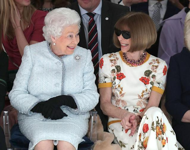 <p>YAS, QUEEN. William and Harry's grandma smiled big while sitting next to <em>Vogue</em>'s Editor-in-Chief at Richard Quinn's runway show in London on Tuesday. After the runway looks, the Queen mum presented the designer with the inaugural Queen Elizabeth II Award for British Design. (Photo: Yui Mok-Pool/Getty Images) </p>