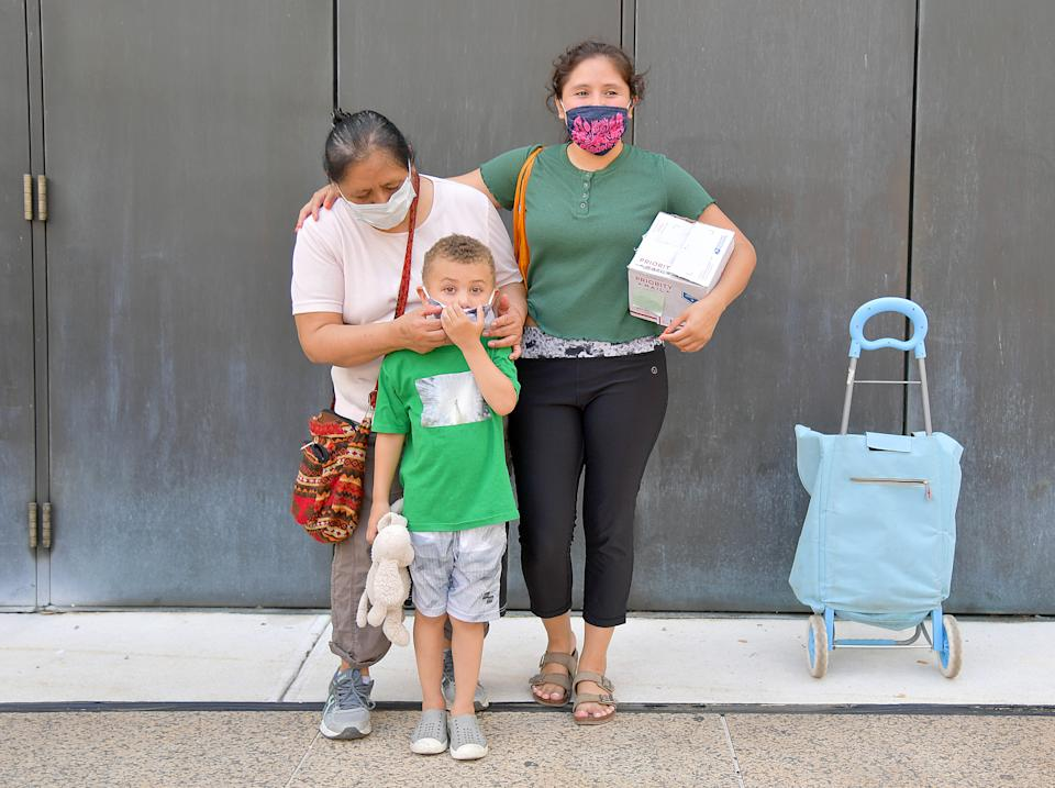 Maria and her family are one of many New Yorkers in need to receive free produce, dry goods, and meat at a Food Bank For New York City distribution event at Lincoln Center on July 29, 2020, in New York City. (Photo by Michael Loccisano/Getty Images for Food Bank For New York City)