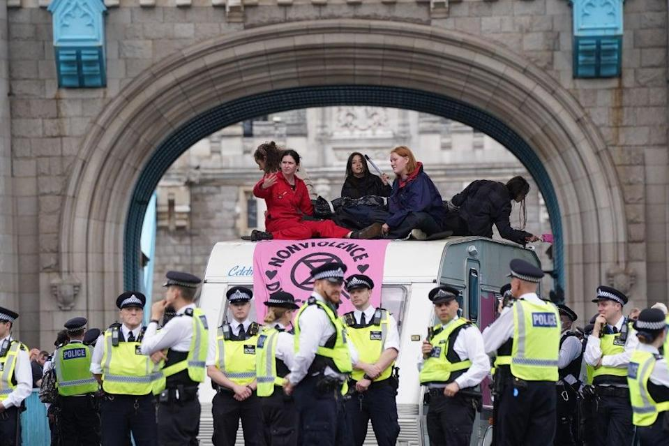 Police by a caravan on Tower Bridge, central London after members of Extinction Rebellion blocked the road (Stefan Rousseau/PA) (PA Wire)