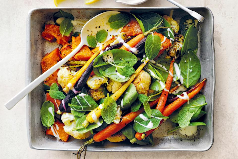 """Mix and match your favorite fall vegetables (carrots, cauliflower, beets, and more) into this delicious side dish that's also a spinach salad. <a href=""""https://www.epicurious.com/recipes/food/views/honey-roasted-vegetable-salad?mbid=synd_yahoo_rss"""" rel=""""nofollow noopener"""" target=""""_blank"""" data-ylk=""""slk:See recipe."""" class=""""link rapid-noclick-resp"""">See recipe.</a>"""