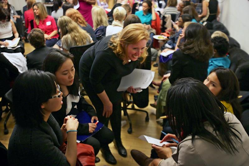 """This April 16, 2013 photo provided by Wix Lounge shows organizer Mary Dove, talking to a group of women at a """"lean in"""" meeting in New York. The group is inspired by Facebook COO Sheryl Sandberg's book """"Lean In"""" which seeks to empower women in the workplace. (AP Photo/Wix Lounge, Galo Delgado)"""