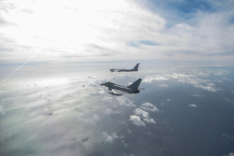An RAF Eurofighter Typhoon (near) intercepting a Russian Bear F aircraft (far),: PA