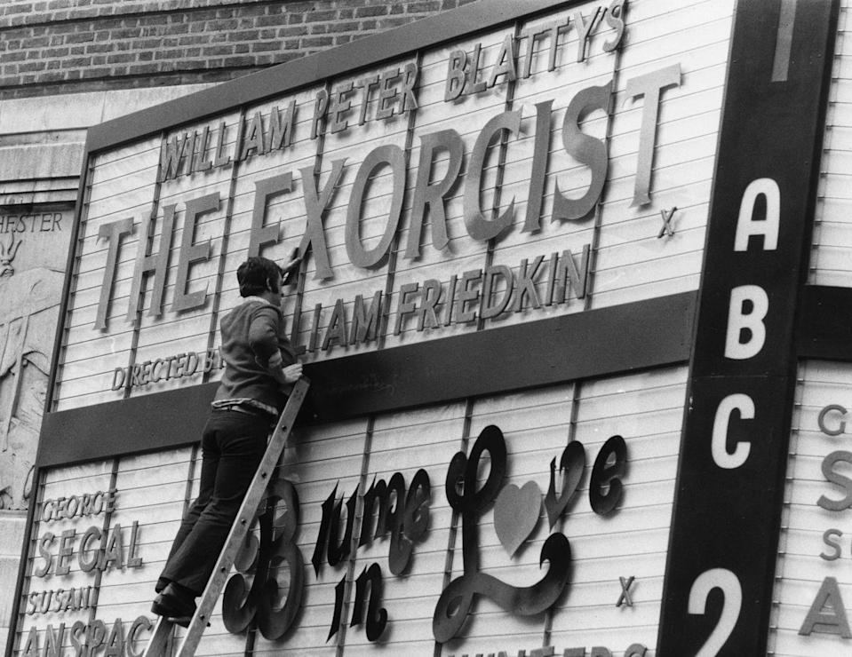 <p>A theater worker puts up the marquee letters for the 1973 premiere of <em>The Exorcist</em>. The film was the first horror movie ever to earn a Best Picture nomination at the Academy Awards.</p>