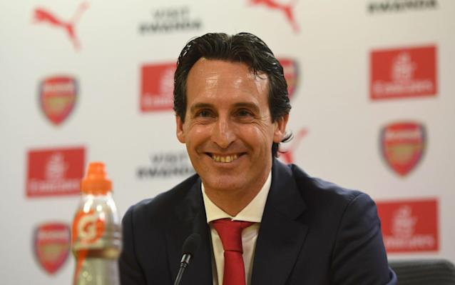 "Unai Emery has promised that his Arsenal team will be fearless in their pursuit of restoring the club to the top of English football, despite chief executive Ivan Gazidis warning fans to be patient. Arsenal have handed Emery a three-year contract to succeed Arsene Wenger and the Spaniard will have to work with a strict £50 million transfer budget. Emery has admitted there is unlikely to be an overhaul of the squad which finished 37 points and five places behind Premier League champions Manchester City, but he is confident he can turn them into trophy hunters again. Asked whether Arsenal could catch City next season, Emery said: ""That is our objective. Arsenal is a club with fantastic personality and identity, and I believe and the club has shown me that they believe. It is about showing that personality and showing the stature of this football club. ""What we want to do is not fear any team, neither here in the Premier League nor in Europe, and our objective is to be among the best and to beat the best. ""The target is to be a candidate and to challenge for the title. It is important for the club after two years outside of the Champions League to work this way. We need to be in the best club in the Premier League and in the world."" Gazidis is confident he has the right man to reunite the club and bring success but is aware progress may be slow. ""I think we need to understand that success isn't instant,"" said Gazidis. ""So, this is going to be a process. As Unai said, day after day you try to improve a little bit, you try to move forward. That's what we have to do. ""We have to work hard, we have to work well together and take this step by step. There are so many stories in sport of people who achieve things that were not believed possible at the beginning of the journey, because they focused on that process of just getting a little better every day. ""It's not going to be instant. So, this kind of significant change in a club doesn't deliver instant success, nobody is naive enough to think that. But I do think the new way of working, the new energy, stimulates the environment and I think it's going to be very positive. I could not possibly feel better about this appointment."" Emery with Ivan Gazidis at the Emirates Credit: Getty images Handed the title of head coach, rather than manager, Emery will have to work closely with head of recruitment Sven Mislintat over transfers, but he is not expecting to make big changes to the squad. ""We think we need change, very little, a little bit with the players,"" said Emery. ""I know all the players, I think they are very important and I want to be with them. But I want to speak to them individually and to speak with them face to face. ""I think it is about having belief in the players. We will have time to speak about where we need to improve, we have already touched on that a little bit. We do need to go into more detail but we have got that strong nucleus, if you like. ""I'm the type of coach who has always worked really hard, not because I do it better than anyone else but because that is what I believe the most important thing is. ""I'm very demanding of myself, I'm passionate and I really want to transmit that to the people around me – that we can and must improve in the future."" Unai Emery: what style can Arsenal expect from their new manager? Emery wasted no time in conveying his message within the club, as he addressed his new staff for the first time over a conference call. Ahead of his first press conference, Emery, together with Gazidis, told members of staff that he wanted to create a new history and a great future for Arsenal. Expanding on that point in front of the media, Emery said: ""I think the most important thing is to connect with people and have those personal relationships. Heart to heart, head to head. The heart transmits emotion, the head transmits the intelligence. ""So, it's really important to have that connection both on a personal and collective level. What you are looking for is a shared experience. I'm a coach that has come from the second division, gone through to the first division, coached at Paris Saint-Germain and now at Arsenal. And, really, the essence of it all is people."""