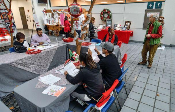 PHOTO: In this Dec. 5, 2017, file photo, volunteers comb through letters to Santa written by needy kids at the post office in Los Angeles. (Jeff Gritchen/Digital First Media/Orange County Register via Getty Images, FILE)