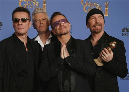 "U2 pose backstage with their award for Best Original Song for ""Ordinary Love"" from the film ""Mandela: Long Walk to Freedom"" at the 71st annual Golden Globe Awards in Beverly Hills"