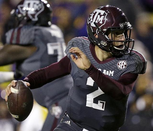 Texas A&M quarterback Johnny Manziel (2) scrambles in the second half of an NCAA college football game against LSU in Baton Rouge, La., Saturday, Nov. 23, 2013. LSU won 34-10. (AP Photo/Gerald Herbert)