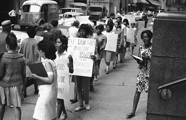 <p>Pickets of the Student Non-Violent Coordinating Committee parade in front of the Federal Building in Boston, June 24, 1964, calling on President Johnson to send 1,000 marshals to Mississippi to protect civil rights workers. (Photo: AEB/AP) </p>