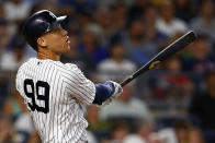 New York Yankees designated hitter Aaron Judge watches his solo home run during the first inning of a baseball game against the Boston Red Sox, Sunday, Aug. 4, 2019, in New York. (AP Photo/Adam Hunger)