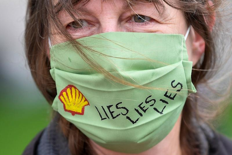 A slogan is seen on a protective face mask of an Extinction Rebellion climate action group protester as she demonstrates against multinational gas and oil firm Shell in London last month. (Photo: Toby Melville / Reuters)