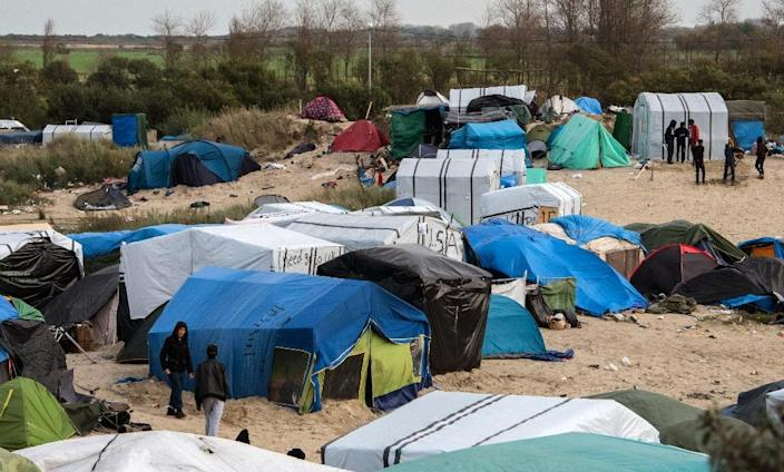 """At least 4,500 migrants and refugees live in notoriously squalid conditions in the sprawling makeshift camp known as the """"Jungle"""" located in the northern French port city of Calais (AFP Photo/Denis Charlet)"""