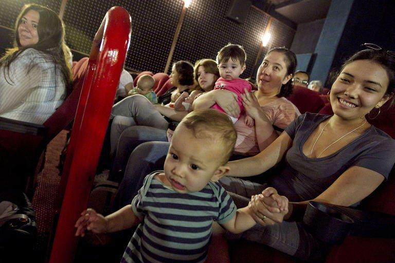 Mothers with their toddlers await for the start of the projection at a movie theatre as part of the CineMaterna program, in Sao Paulo, Brazil, in April 2011. CineMaterna is an NGO that promotes the return of mothers of up to eighteen-month-old babies to the cultural life by offering them specially suited movie sessions