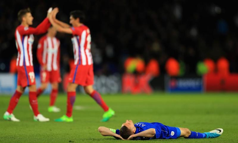 Jamie Vardy displays Leicester City's despair as the Atlético Madrid players celebrate after the Champions League quarter-final second leg draw at the King Power Stadium.