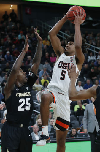 Oregon State's Ethan Thompson (5) shoots over Colorado's McKinley Wright IV (25) during the second half of an NCAA college basketball game in the quarterfinals of the Pac-12 men's tournament Thursday, March 14, 2019, in Las Vegas. (AP Photo/John Locher)