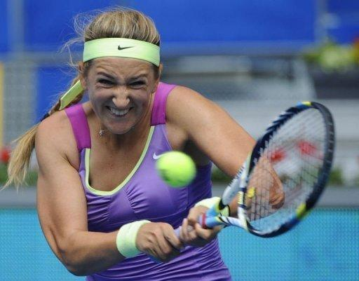 Belarussian Victoria Azarenka returns a ball to Poland's Agnieszka Radwanska
