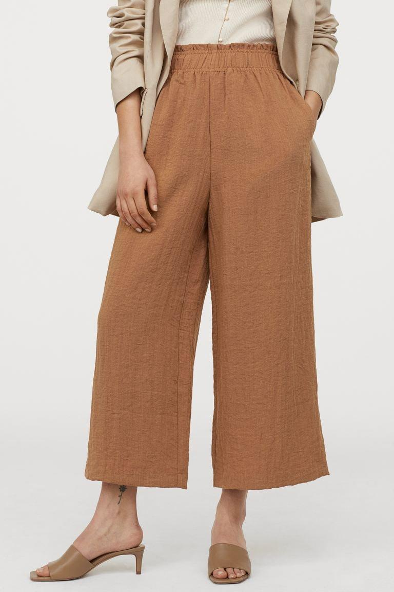 "<p>If you love neutral colors, get these <a href=""https://www.popsugar.com/buy/HampM-Wide-Leg-Pants-573086?p_name=H%26amp%3BM%20Wide-Leg%20Pants&retailer=www2.hm.com&pid=573086&price=30&evar1=fab%3Aus&evar9=47085485&evar98=https%3A%2F%2Fwww.popsugar.com%2Ffashion%2Fphoto-gallery%2F47085485%2Fimage%2F47462873%2FHM-Wide-Leg-Pants&list1=shopping%2Cpants%2Cworkwear%2Cfashion%20shopping&prop13=mobile&pdata=1"" class=""link rapid-noclick-resp"" rel=""nofollow noopener"" target=""_blank"" data-ylk=""slk:H&amp;M Wide-Leg Pants"">H&amp;M Wide-Leg Pants</a> ($30).</p>"