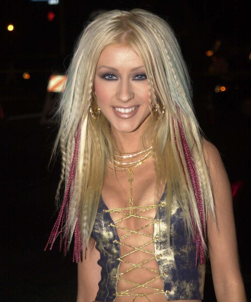 "<h3>Christina Aguilera<br></h3><br>A hair icon of the early 2000s, Christina Aguilera made us beg our moms for a crimper and colored hair extensions. And if this inspiration isn't doing it for you, look back at how <a href=""https://www.refinery29.com/en-us/2016/10/128075/kylie-jenner-dirrty-christina-aguilera-halloween#slide-1"" rel=""nofollow noopener"" target=""_blank"" data-ylk=""slk:Kylie Jenner styled Xtina"" class=""link rapid-noclick-resp"">Kylie Jenner styled Xtina </a>circa Halloween 2016.<span class=""copyright"">Photo: Jeff Kravitz/FilmMagic.</span>"