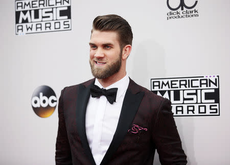 FILE PHOTO: Baseball player Bryce Harper arrives at the 2016 American Music Awards in Los Angeles, California, U.S., November 20, 2016. REUTERS/Danny Moloshok