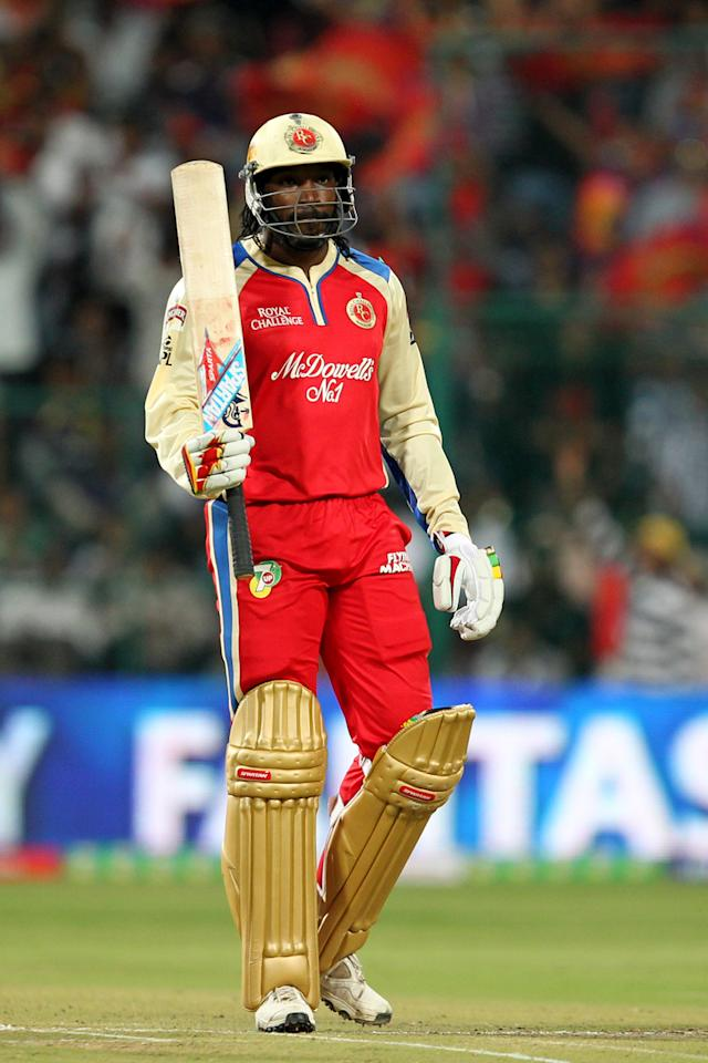 Chris Gayle raises bat on completing half century during match 12 of the Pepsi Indian Premier League between The Royal Challengers Bangalore and The Kolkata Knight Riders  held at the M. Chinnaswamy Stadium, Bengaluru  on the 11th April 2013Photo by Prashant Bhoot-IPL-SPORTZPICS Use of this image is subject to the terms and conditions as outlined by the BCCI. These terms can be found by following this link:https://ec.yimg.com/ec?url=http%3a%2f%2fwww.sportzpics.co.za%2fimage%2fI0000SoRagM2cIEc&t=1498233323&sig=RmJ9DfqbcBSRLFJrWH8LBw--~C
