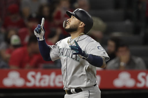 Seattle Mariners' Omar Narvaez celebrates his three-run home run during the seventh inning of the team's baseball game against the Los Angeles Angels, Thursday, April 18, 2019, in Anaheim, Calif. (AP Photo/Jae C. Hong)