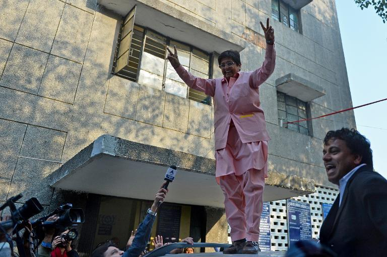 Kiran Bedi, Bharatiya Janata Party candidate for Delhi chief minister, greets supporters after casting her vote at a polling station in New Delhi on February 7, 2015