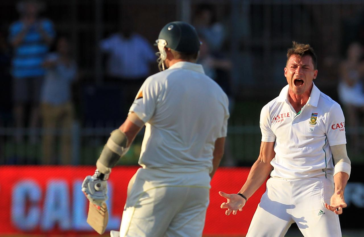 South Africa's bowler Dale Steyn, right, celebrates after dismissing Australia's batsman Ryan Harris, left, on LBW six runs on the fourth day of their second cricket test match at St George's Park in Port Elizabeth, South Africa, Sunday, Feb. 23, 2014. (AP Photo/ Themba Hadebe)