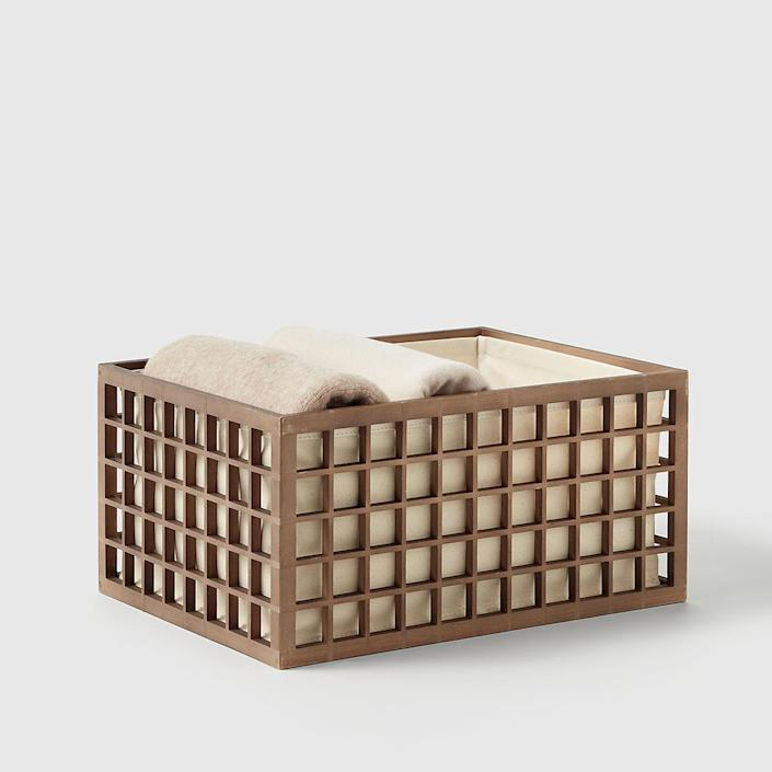 "<h2>Marie Kondo Shoji Bamboo Bin</h2><br><strong>Resolution: Get Organized</strong><br>Marie Kondo and The Container Store collaborating on a line of home goods definitely, ""sparks joy."" If you're deadset on keeping your living space tidy (or just tidier) in 2021 then we highly suggest taking a peek at this minimalistic organization oasis. In her collection, you'll find desk essentials, ceramic canisters, Kawaii pouches, and more vessels to stash away all of your clutter in fashion. <br><br><em>Shop</em> <strong><em><a href=""https://www.containerstore.com/s/marie-kondo-collection/1"" rel=""nofollow noopener"" target=""_blank"" data-ylk=""slk:The Marie Kondo Collection"" class=""link rapid-noclick-resp"">The Marie Kondo Collection</a></em></strong><br><br><strong>Marie Kondo</strong> Shoji Bamboo Bin, $, available at <a href=""https://go.skimresources.com/?id=30283X879131&url=https%3A%2F%2Fwww.containerstore.com%2Fs%2Fmarie-kondo-collection%2Fshop-by-category%2Fcloset-storage%2Fmarie-kondo-shoji-bamboo-bin%2F123d%3FproductId%3D11014765"" rel=""nofollow noopener"" target=""_blank"" data-ylk=""slk:The Container Store"" class=""link rapid-noclick-resp"">The Container Store</a>"