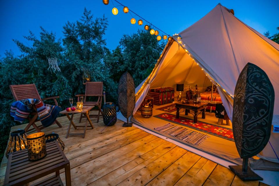 glamping tent outside at night