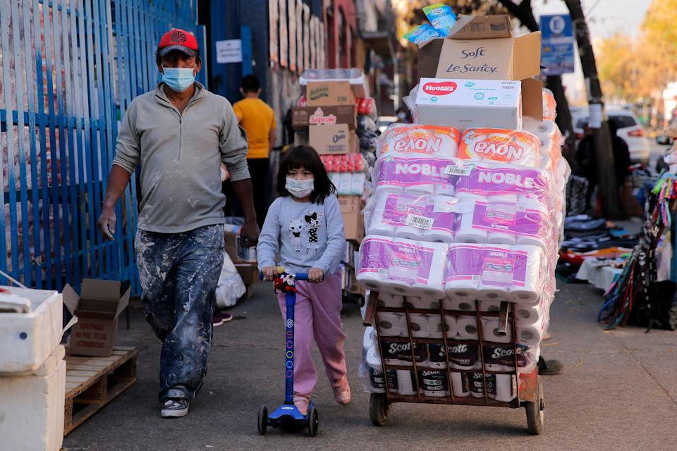 People walk at a commercial area of the Quinta normal commune in Santiago, on June 10, 2021. Chilean authorities have imposed  a new total lockdown in the Santiago metropolitan region due to an increase in coronavirus cases, despite around 58 per cent of the population being already vaccinated.  (AFP via Getty Images)