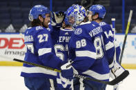 Tampa Bay Lightning goaltender Andrei Vasilevskiy (88) celebrates with defenseman Ryan McDonagh (27) after the team defeated the Chicago Blackhawks during an NHL hockey game Wednesday, Jan. 13, 2021, in Tampa, Fla. (AP Photo/Chris O'Meara)