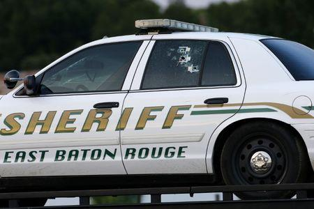 An East Baton Rouge Sheriff vehicle is seen with bullet holes in its windows near the scene where police officers were shot, in Baton Rouge