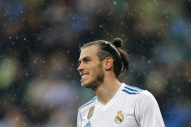 Real Madrid's Gareth Bale reacts during a Spanish La Liga soccer match between Real Madrid and Villarreal at the Santiago Bernabeu stadium in Madrid, Spain, Saturday, Jan. 13, 2018. (AP Photo/Paul White)
