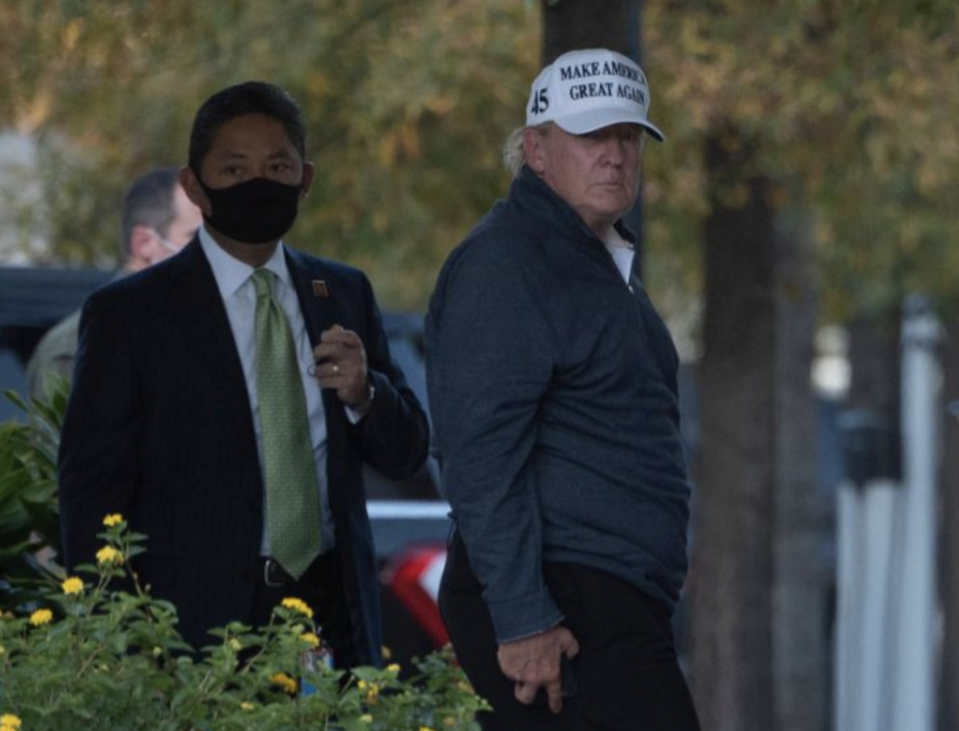 Donald Trump shown entering the White House after news of his loss was publicised.