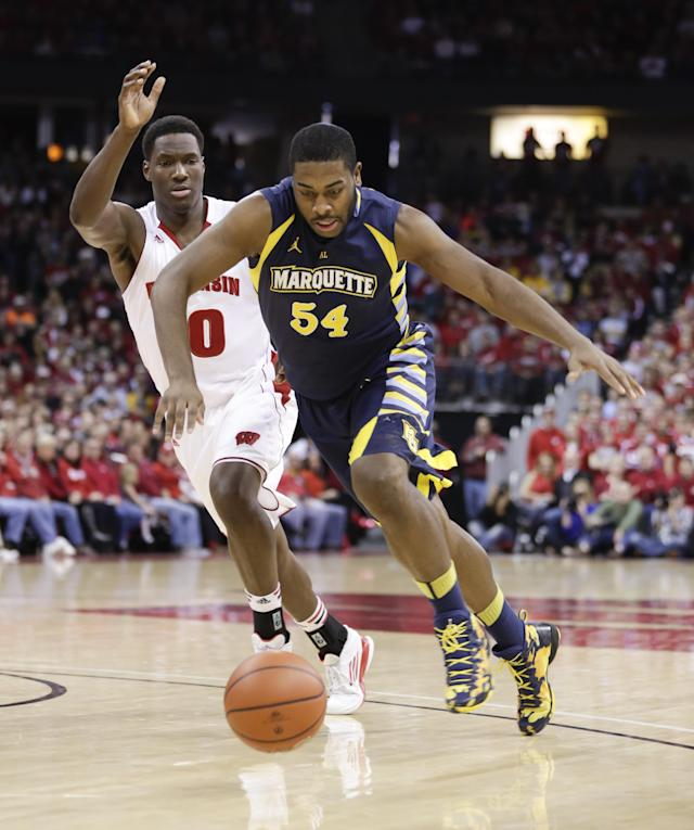 Wisconsin's Nigel Hayes, left, and Marquette's Davante Gartner go after a loose ball during the first half of an NCAA college basketball game Saturday, Dec. 7, 2013, in Madison, Wis. (AP Photo/Andy Manis)