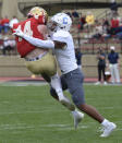 VMI receiver Jakob Herres (14) is hit mid-air by The Citadel's Parrish Gordon after making a catch for a first down during an NCAA college football game Saturday, April 17, 2021, in Lexington, Va. (David Hungate/Roanoke Times via AP)