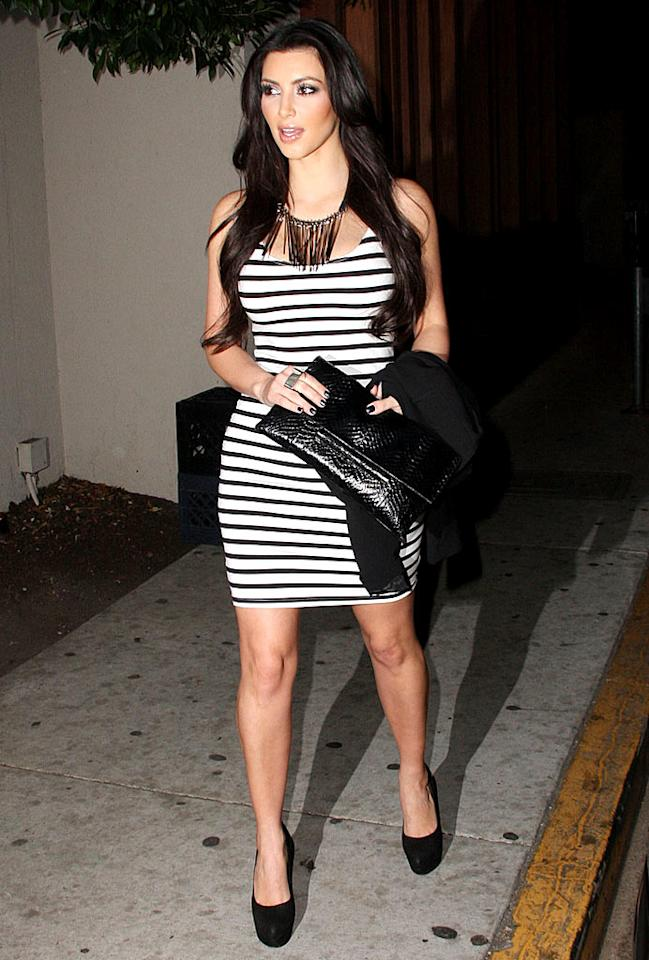 "Most celebs fear horizontal stripes, but Kim Kardashian can actually rock them. Case in point: this black-and-white beauty, which the reality star paired with a funky necklace, Yves St. Laurent platform pumps, and a python clutch. Greg Tidwell/<a href=""http://www.pacificcoastnews.com/"" target=""new"">PacificCoastNews.com</a> - January 5, 2010"