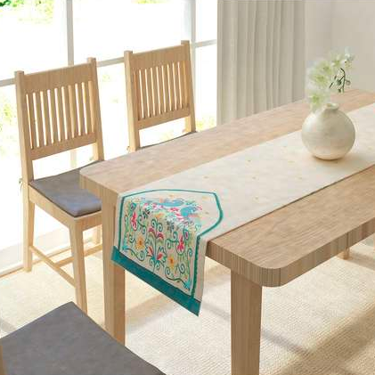 "The cotton, embroidered <a href=""https://fave.co/37xEScb"" rel=""nofollow noopener"" target=""_blank"" data-ylk=""slk:Peacock table runner by IVY"" class=""link rapid-noclick-resp""><strong>Peacock table runner by IVY</strong></a>. Size: 13 X 72 inches. <em>Rs.999.</em> <a href=""https://fave.co/37xEScb"" rel=""nofollow noopener"" target=""_blank"" data-ylk=""slk:Buy here!"" class=""link rapid-noclick-resp""><strong>Buy here!</strong></a>"