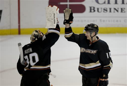 Anaheim Ducks goalie Viktor Fasth, left, of Sweden, and Corey Perry celebrate their team's 5-2 win against the Dallas Stars after an NHL hockey game in Anaheim, Calif., Wednesday, April 3, 2013. (AP Photo/Jae C. Hong)