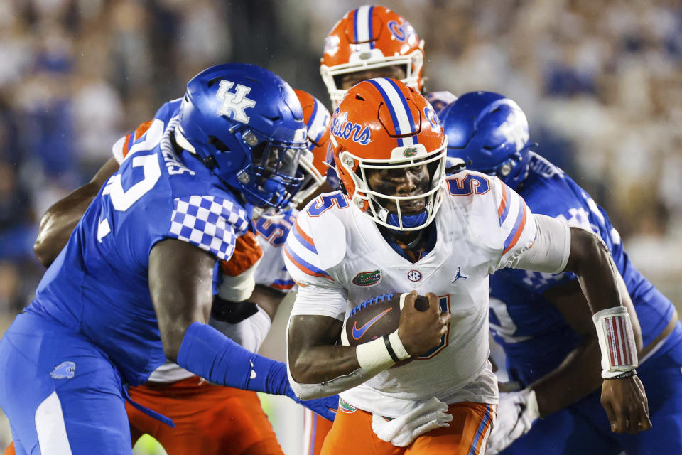 Florida quarterback Emory Jones (5) runs the ball upfield during the second half of an NCAA college football game against Kentucky in Lexington, Ky., Saturday, Oct. 2, 2021. (AP Photo/Michael Clubb)