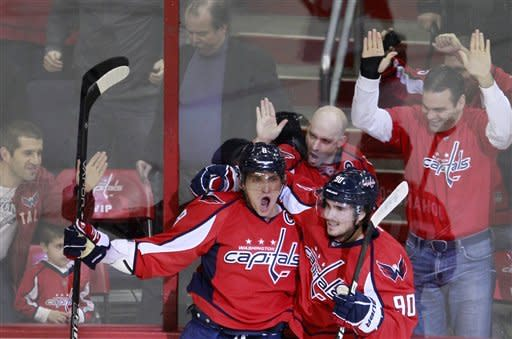 Washington Capitals left wing Alex Ovechkin, left, of Russia, celebrates his power-play goal with teammate Marcus Johansson, of Sweden, during the first period of an NHL hockey game against the Florida Panthers, Tuesday, Feb. 7, 2012, in Washington. (AP Photo/Haraz Ghanbari)