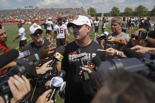 Cincinnati Bengal head coach Zac Taylor speaks with the media after the first day of NFL football training camp Saturday, July 27, 2019, in Dayton, Ohio. (AP Photo/Bryan Woolston)
