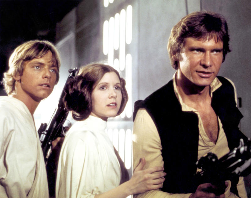 "Mark Hamill, Carrie Fisher and Harrison Ford, pictured on the set of ""Star Wars,"" owe their look in part to John Mollo. (Sunset Boulevard via Getty Images)"